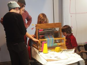 Campers lead a weaving session at the eTextile Spring Break Social